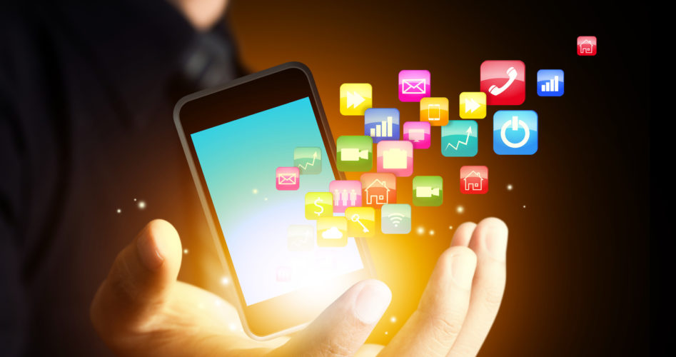 Smartphone with cloud of application icons in consumer hand